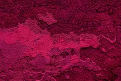 Crimson colored abstract wall background with textures of different shades of crimson and red