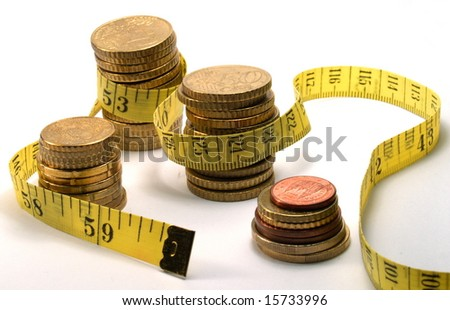 crisis: measuring tape and coins isolated on white