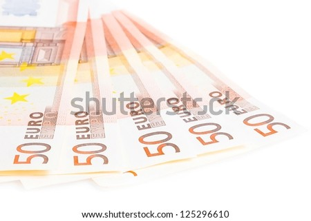 crisis of eurozone, detail of some 50-euro banknotes on white background