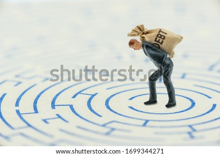 Crisis of high burden of consumer debt, financial concept : Client bears a bag of debt and find the way to escape. Debtor has difficult problem of bad debt and plan to pay back to lender or creditor.