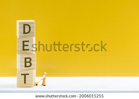 Crisis of high burden of consumer debt, financial concept : Client drags cubes of debt and find the way to escape. Debtor has difficult problem of bad debt and plan to pay back to lender or creditor.