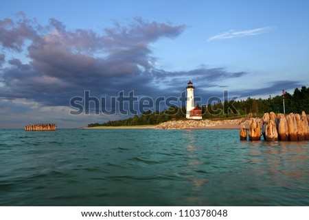 Crisp Point Lighthouse. Image of the Crisp Point Lighthouse at sunset.