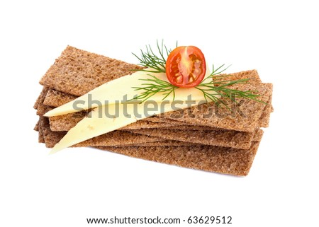 Crispbread with cheese, tomato and dill isolated on white. Healthy breakfast. - stock photo