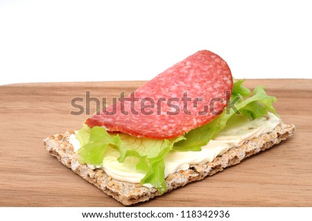 Crispbread with cream  cheese, lettuce and salami