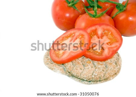 Crispbread with tomatoes, isolated on white