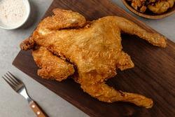 Crispy and savory deep-fried whole chicken