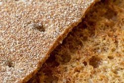 Crispy bread slices. Rye crackers. The texture of brown bread. Rough bread surface