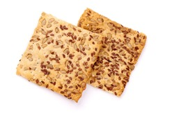 Crispy breads with sesame and flax seeds, crackers, isolated on white background.