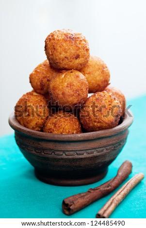 Crispy cheese balls deep fried with cinnamon