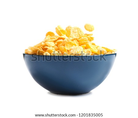 Crispy cornflakes falling into bowl on white background #1201835005
