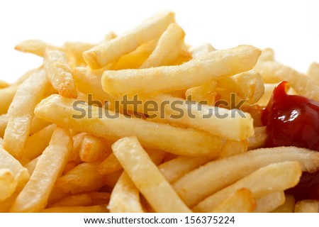 Crispy French fries with ketchup ready to eat
