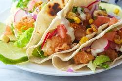 Crispy fried boom boom shrimp tacos with rice