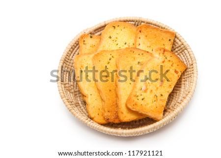 Crispy garlic bread in basket on white background