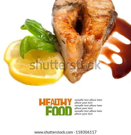 Crispy grilled salmon steak with lemon and basil
