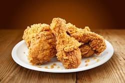 crispy kentucky fried chicken in a wooden table