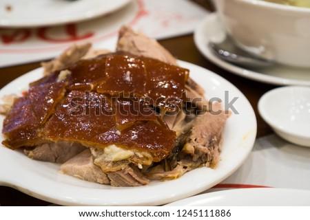 crispy oily skin of lechon or roast pig