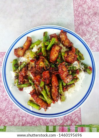 Crispy roasted pork stir fry with vegetables and rice  Images and