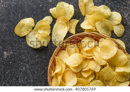 crispy potato chips in a wicker ...