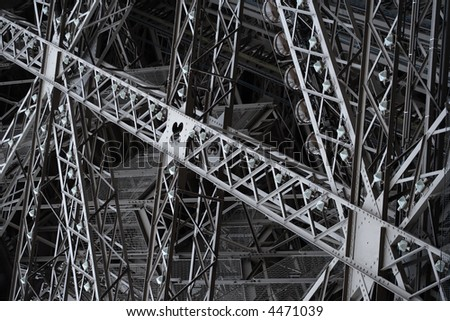 Criss-crossing steel supports of the Eiffel Tower. #4471039