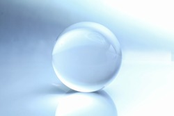 Cristal ball with reflection and shaddy background