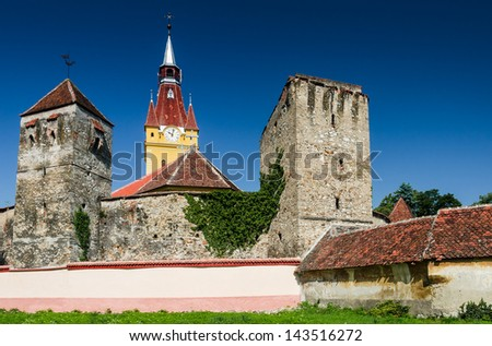 Cristian village, fortified saxon church built in romanic style, with gothic sculptural elements. Transylvania, Romania.