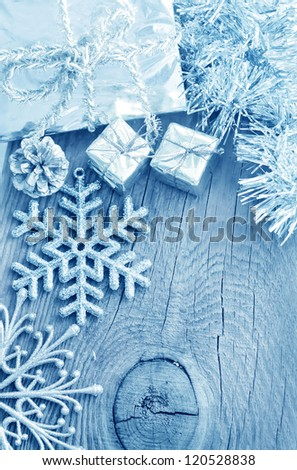 Cristmas decoration on the wooden background, present and snowflakes