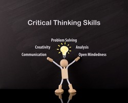 Critical Thinking Skills Concept, Wooden Stick Figure arms up, Big Yellow light bulb sketch, on a chalkboard