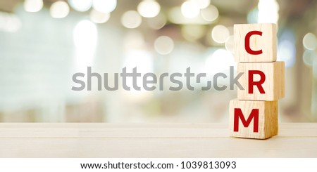CRM banner, Customer Relationship Management, on wooden cubes over blur background with copy space, success in business concept