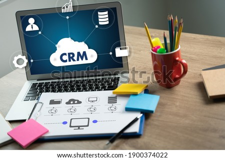 CRM Business Customer CRM Management Analysis Service Concept Business team hands at work with financial reports and a laptop Сток-фото ©