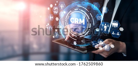 CRM Customer Relationship Management for business sales marketing system concept presented in futuristic graphic interface of service application to support CRM database analysis. Сток-фото ©