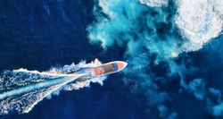 Croatia. Aerial view of luxury floating boat on blue Adriatic sea at sunny day. Fast boat on the sea surface. Seascape from drone. Travel - image