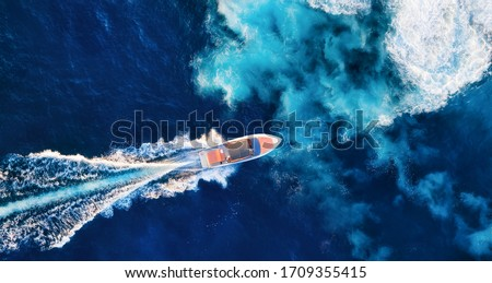 Croatia. Aerial view of luxury floating boat on blue Adriatic sea at sunny day. Fast boat on the sea surface. Seascape from drone. Travel - image stock photo