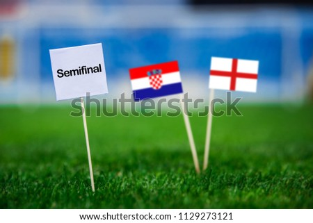 """Croatia and Englandnational Flag on football green grass. White table with tittle """"SEMIFINAL"""" Croatia - England, Semifinal. 11. July, Football World Cup,  #1129273121"""