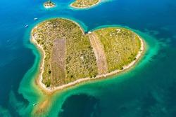 Croatia, beautiful coastline on Adriatic sea, romantic heart shaped island of Galesnjak, aerial drone view