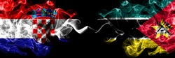 Croatia, Croatian vs Mozambique, Mozambican smoky mystic flags placed side by side. Thick colored silky abstract smoke flags.