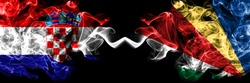 Croatia, Croatian vs Seychelles, Seychellois smoky mystic flags placed side by side. Thick colored silky abstract smoke flags.