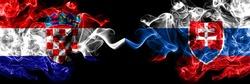 Croatia, Croatian vs Slovakia, Slovakian smoky mystic flags placed side by side. Thick colored silky abstract smoke flags.