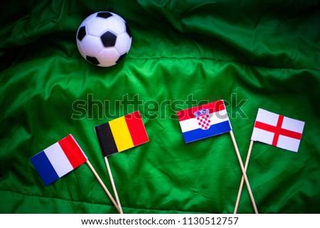 Croatia, England, France and Belgium national flags on green football grass.  #1130512757