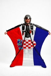 Croatia flag travel. Bird Men in wing suit flag. Sky diving men in parashute. Patriotism, men and flag.