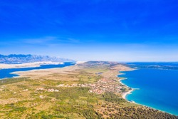 Croatia, green side of the island of Pag, agriculture fields and Adriatic sea coastline