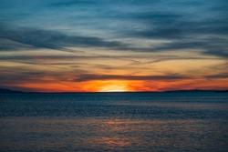 Croatia, island of Pag, beautiful dramatic sunset over Adriatic sea horizon, red sky