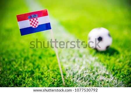 Croatia national Flag and football ball on green grass. Fans, support photo, edit space.  #1077530792