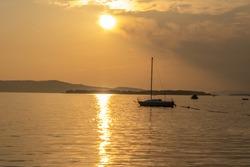 croatia sibenik summer holiday tourist destination vie of red sunset sea with boat