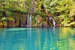 Croatian National Park Plitvice lakes. Majestic view on waterfall with turquoise water and karst cascading lakes