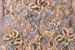 Crochet knitting. Lace of flowers.  Handmade Irish lace as a background