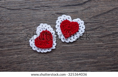 crochet lace white and red hearts knitted frame with handmade needlework day backdrop