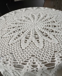 Crochet round doily tablecloth stock photo