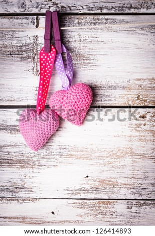 Crochet valentine hearts handing on the rope. Valentine's day greeting card. Love concept