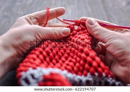 Crocheted .\ncrochet box and steel crochet hook.