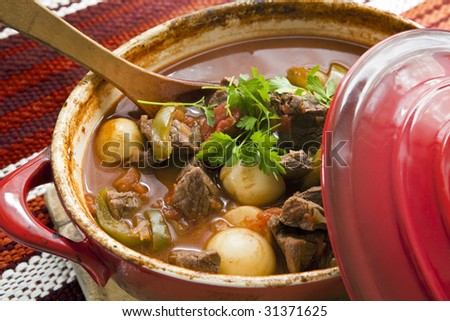 Crock pot of beef goulash, ready to serve.  Lovely warming food.